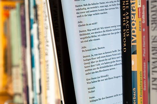 512px-EBook_between_paper_books